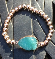 Rose Gold Plated with torquoise resin stone