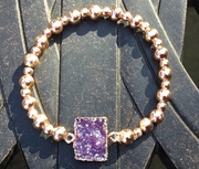 Rose gold plated with purple resin stone